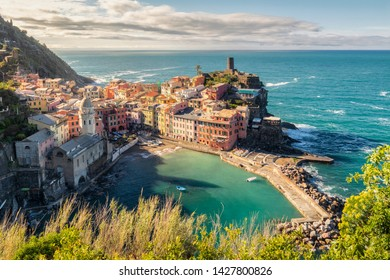 View of the beautiful sunrise seaside of Vernazza village in summer in the Cinque Terre area