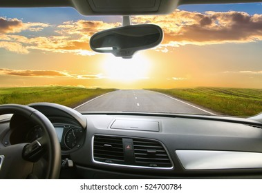 view of beautiful sunset from the interior of cars