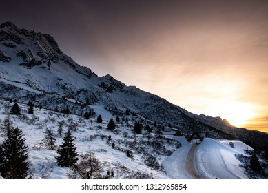 View of a beautiful sunset over the Tonale Pass and the the mountains around it, during a winter sunny day. Tonale is a mountain pass between Lombardy and Trentino, near the Presena glacier
