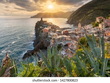 View of the beautiful sunset seaside of Vernazza village in summer in the Cinque Terre area