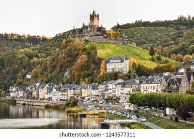 View at the beautiful town of Cochem and Cochem castle on top of the hill, surrounded by vineyards