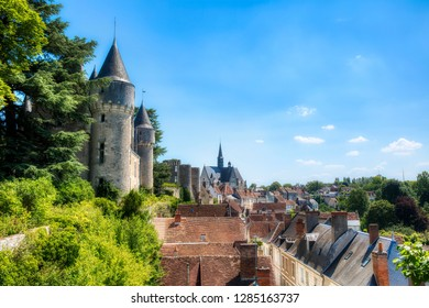 View of the Beautiful Village of Montresor, Loire, France, with St John the Baptist Collegiate Church and Towers of Montresor Castle