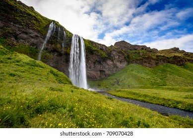 view of beautiful waterfall Seljalandsfoss in summer, south Iceland; selective focus