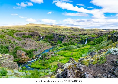 View of the beautiful Waterfalls in Gjain Canyon in summer at the Highlands of Iceland