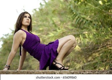 View of a beautiful woman on a narrow bridge