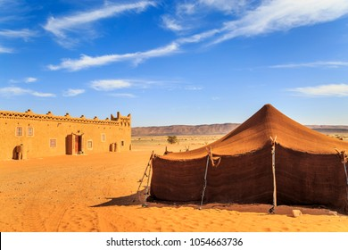 view of bedouin tent with clear blue sky above it