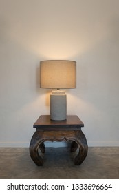view of the bedside  lamp on the grey concrete wall background