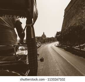 View from Behind the Driver of Horse Carriage in Sepia, Captured at Valletta Malta Summer 2018, Dome of Carmelite Church in background, street photography