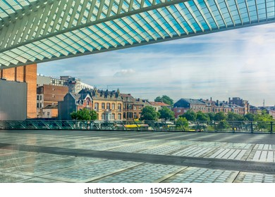 View of the Belgian city of Liege and the railroad landing stage from the window of a passing train.