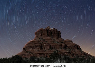 A view of Bell Rock at night with stars rotating