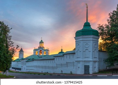 View to bell tower and walls of Our Savior Transfiguration monastery from Kotorosl river embankment in summer evening at sunset. Yaroslavl, Golden Ring of Russia. UNESCO world heritage site