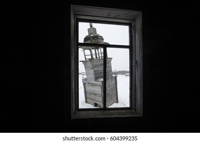 View of the bell from the window. Russia, Arkhangelsk region, Onega district, Nimenga village