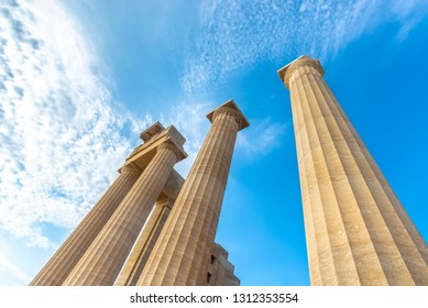 View from below of a beautiful antique pillars of acropolis Lindos Greece.
