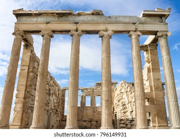 View from below of the Erechtheion temple of Athena on the Athens Acropolis against a very blue sky with wispy clouds