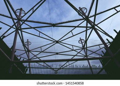 View from below look up to construction roof structure with blue sky and white cloud upper.