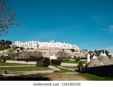 View from below of the town of Locorotondo in Puglia, southern Italy.