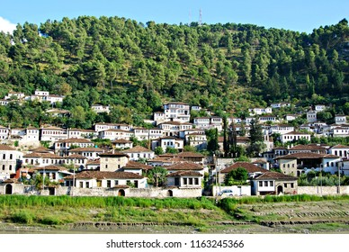 View of Berat ottoman old town from the shore of Osum river.