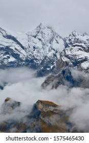 The view of Bernese Alps of Switzerland from Schilthorn's summit in the misty day. In the distance are the peak of Eiger, Monch, and Jungfrau.