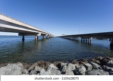 View in between the two actual bridges, the Ted Smout Memorial Bridge (left) and the Houghton Bridge (right), which cross the Bramble Bay connecting the Redcliffe Peninsula to Brigthon