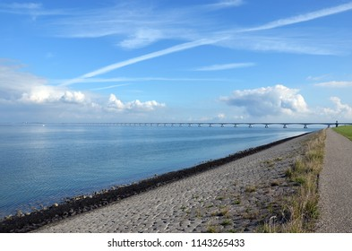 View from the bicycle path along the North Beveland shore towards Zeeland Bridge across Oosterschelde estuary in the Netherlands.