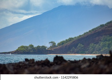 View of Big Beach (Makena State Park) with lava rock in the foreground. Big Beach is located on the island of Maui in Hawaii.
