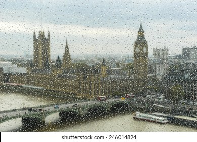 view to Big Ben and parliament through the wet window