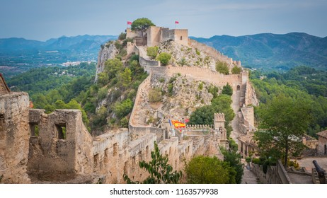 View of bigger Jativa / Xativa medieval castle from the smaller castle in Valencia region on the Mediterranean coast in Spain. Moorish, Romans, and Christians castle built by King James I of Aragon.