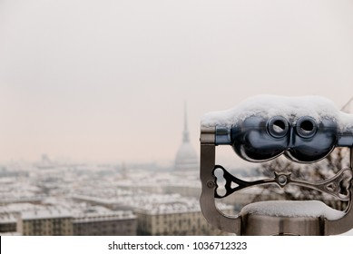 View of Binoculars and Turin city center behind during winter