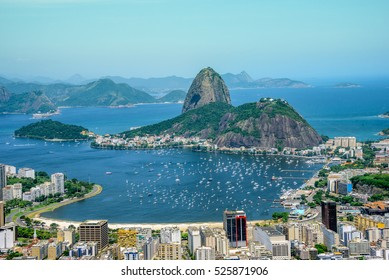 View from the bird's eye view on the Sugarloaf mountain, Botafogo bay with white sailing yachts and city landscape, Rio de Janeiro, Brazil