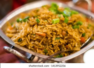 View of Biryani (also known as biriyani, biriani, birani or briyani) with small depth of field.