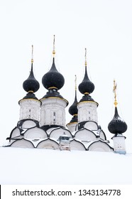 View of the black domes of the white church in winter