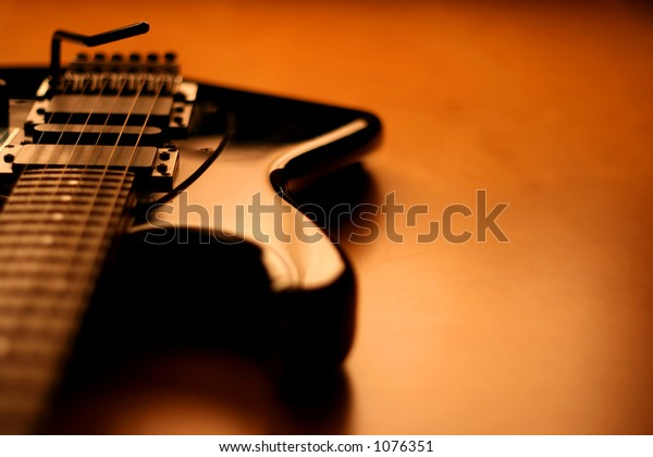 View of a black electric guitar with copy-space
