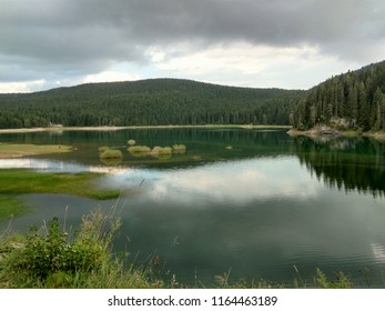 View of black lake, forest and mountains in Durmitor national park
