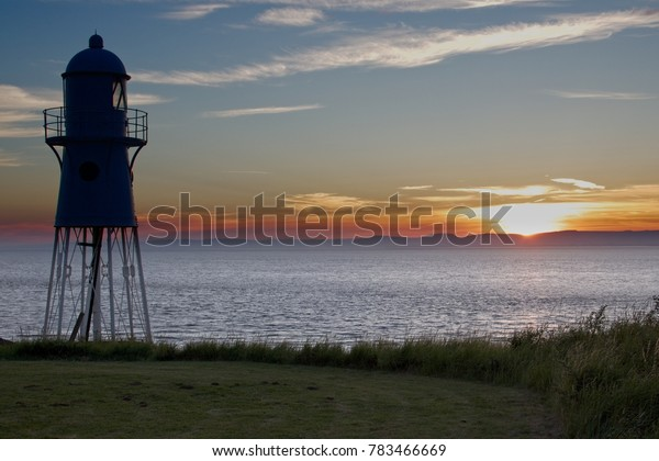 A view of Black Nore Lighthouse on the River Severn at sunset in July with a view of the sea.  Portishead.  16th July, 2017.