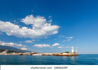 view of Black Sea and lighthouse in Yalta city in summer day. Crimea
