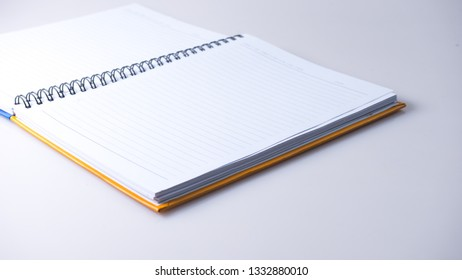 View of blank pages on ring-o type of note pad diary planner. Isolated on white. Copy space.