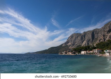 A view of the blue Croatian sea with mountains in the background, merging from the right