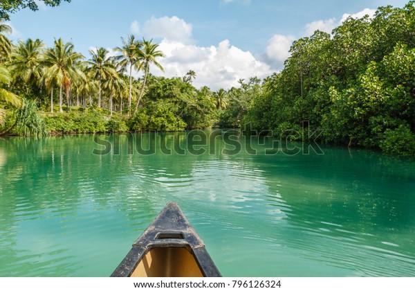 View of a Blue Hole from a boat. Ratua Private Island, Republic of Vanuatu