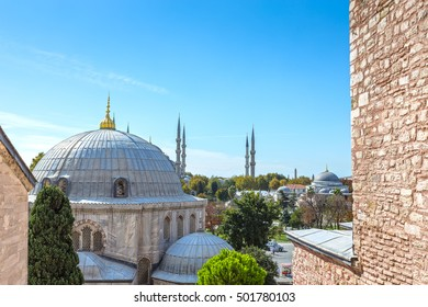 View of the Blue Mosque over the Ottoman Imperial Tombs from a window of the Hagia Sophia museum in Istanbul, Turkey.