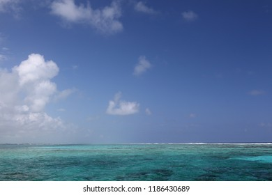 A view of the blue sky above the clear waters of the Caribbean sea