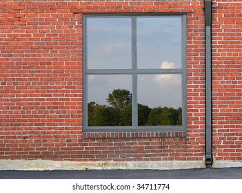 view of blue sky and clouds through a window in brick wall
