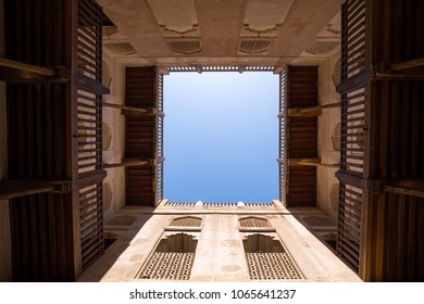 View of a blue sky through a traditional Omani fort courtyard. Nizwa, Oman.