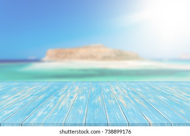 View of blue structured wooden panel on a natural sea background