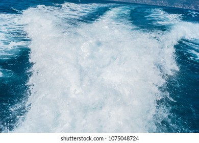 View from board of cutter with blue water and sea foam