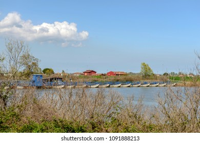 view of  the boat bridge on Po river, shot in bright spring sun light at Goro, Ferrara,  Italy