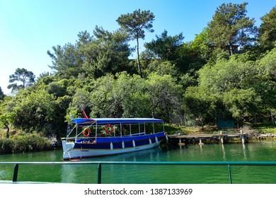 View of a boat in Dalyan river near the trees, Dalyan, Mugla, Turkey, 19.04.2019