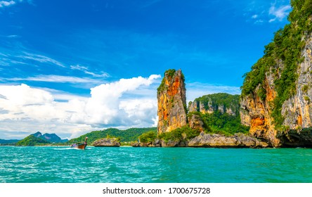 View from boat going to famous Railay beach in Krabi town, Thailand. Favorite place in Thailand with pure sea, white sand and beautiful limestone rocks. Vacation target in tropical paradise.