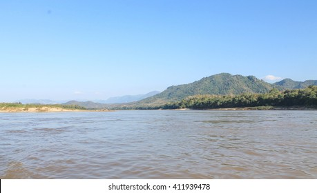 View from the boat to Luang Prabang . Photo mountain middle Mekong to Luang Prabang , Mountain river Photo mountain middle Mekong to Luang Prabang