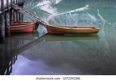 View of boat on water with reflection