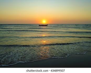 View of the boat in the open sea at the sunset